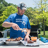 Eric Thomas makes what he called to-go packets of pulled pork at the Kiwanis Cookout on Saturday at Land of Memories park. Thomas said they entered all three amateur categories, ribs, pulled pork and chicken. Photo by Jackson Forderer