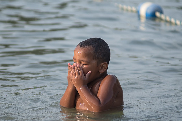 Antavon Hildebrandt, 3, wipes water away from his eyes while swimming at the Spring Lake Park pool on Friday. Antavon's mother said that he had been to the swimming pool everyday since it opened. High winds on Saturday prevented Mankato from reaching 100 degrees. Photo by Jackson Forderer