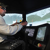 John Cross<br /> Lincoln Wach, a MnDOT snowplow driver from Wells, drives through a snowstorm simulated on three 42-inch flat screen televisions.