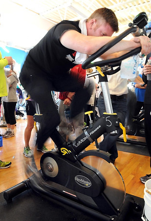 Eric Huges pedals furiously for the Sheels team during Pedal Past Poverty, a fundraiser for Partners for Affordable Housing, Saturday at the Mankato YMCA.