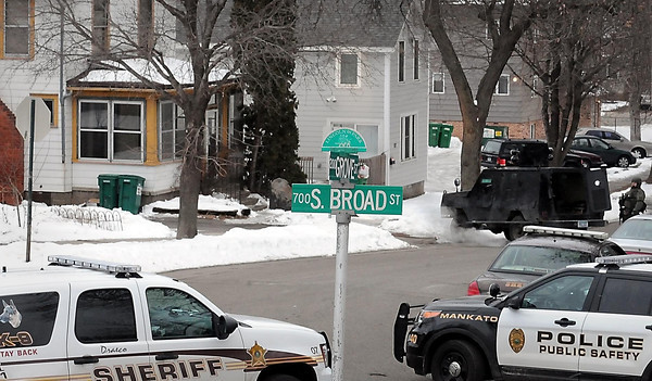 John Cross<br /> Law enforcement vehicles block off the 100 block of Grove Street near Lincoln Park Friday morning. The River Valley Tactical Response Team was mobilized for an incident.