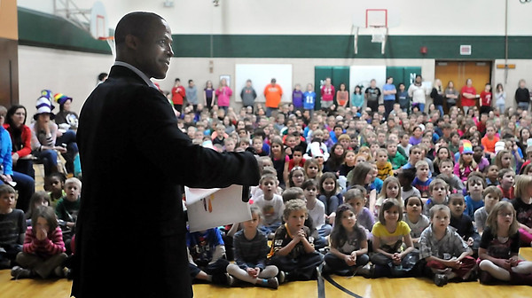 """John Cross<br /> Bukata Hayes, executive director for the Greater Mankato Diversity Council, reads a book to students at Monroe Elementary School Friday as part of """"Read Across America.""""<br /> Students also got a chance to meet Minnesota Wild mascot Nordy to go along with the  school theme for the program  which was """"Wild About Reading.."""""""