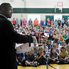 "John Cross<br /> Bukata Hayes, executive director for the Greater Mankato Diversity Council, reads a book to students at Monroe Elementary School Friday as part of ""Read Across America.""<br /> Students also got a chance to meet Minnesota Wild mascot Nordy to go along with the  school theme for the program  which was ""Wild About Reading.."""