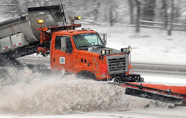 A Minnesota Department of Transportation snowplow rumbles along Highway 169 north of Mankato clearing some of the snow that prompted the shutdown of area schools and created hazardous driving conditions across much of Minnesota.