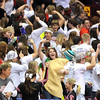 New Richland-Hartland-Ellendale-Geneva fans, one dressed as a taco, dance during their girls basketball team's State Class AA quarterfinal game against Pelican Rapids Wednesday at Williams Arena.