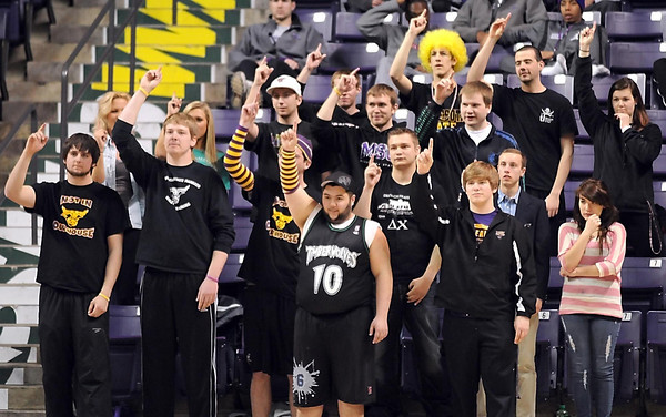 Minnesota State men's basketball fans aim good luck toward their team's free throw shooter during the second half of their NCAA Division II Central Region quarterfinal game Saturday at Bresnan Arena.