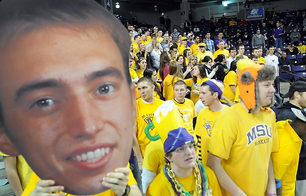 A large poster of Minnesota State basketball player Connor O'Brien's head looms over the student section before Tuesday's NCAA Central Region championship game against Winona State at Bresnan Arena.