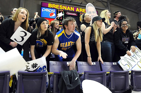 Pat Christman<br /> A Le Sueur Henderson boys basketball fan in school colors stands out in a sea of black as they watch a free throw during a section championship game at Bresnan Arena.