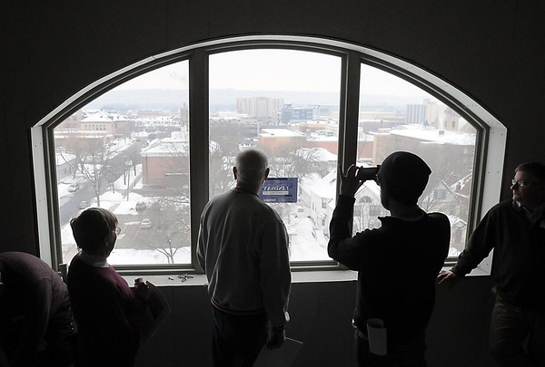 Pat Christman<br /> Visitors take in the scenery from the fourth floor of the former Nichols Office Building, which is being remodeled to be the new VINE Faith in Action building, which for now is being called VINE Adult Community Center, during a tour of the construction last week.