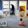 Pat Christman<br /> Kambrie Konz, 2, plays with a doll as Blue Earth County Commissioner Vance Stuehrenberg looks at a model of the new Children's Museum of Southern Minnesota Friday at the museum. The museum will be hosting events at it's interim site on Cherry Street until they close on May 22.