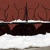 Pat Christman<br /> Snow melts from tables stacked on the patio at Red Rocks Bar and Nightlife last week.