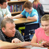 Bridges teacher Jeremy Olson works with sixth grader Alexandria Anton-Drumm on an assignment.