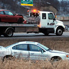 John Cross<br /> Tow truck operators remove vehicles involved in a collision Monday morning near the Highway 169-Highway 14 interchange north of Mankato.
