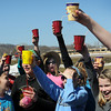 Garfield Elementary sixth graders hoist a toast on Thursday to the first day of spring and having a week's worth of tests behind them. They also played some pond games in the nearby thawed Wheeler Park skating rink.