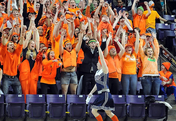 Pat Christman<br /> An entire section of St. Peter boys basketball fans cheers, led by a male classmate in a cheerleader's uniform, during the section boys basketball tournament at Bresnan Arena.