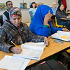 Hayat Liban, left, takes notes during a citizenship class at Lincoln Community Center on Wednesday. Photo by Jackson Forderer