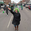 Anne Dempsey, center, leads her group down Minnesota Street during the St. Patrick's Day parade in New Ulm. This is the 52nd second year the parade has been held in New Ulm. Anne's relative Terry Dempsey was one of the founders of the parade. Photo by Jackson Forderer