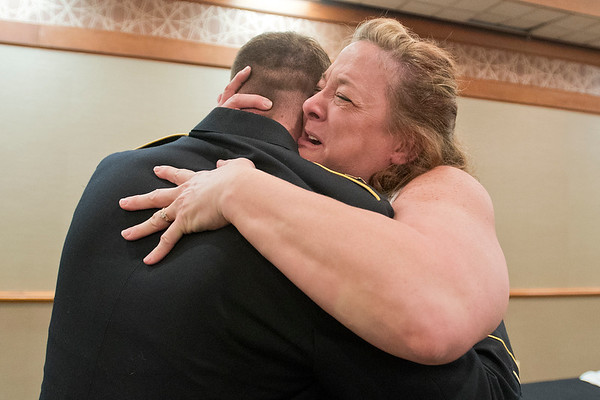 Margaret Pearson hugs her son Sgt. Dustin Pearson after Dustin surprised her at her nursing graduation ceremony at Best Western on Wednesday. Pearson, who is in the 461st Engineer Company, came home from Kuwait and surprised Margaret at her pinning ceremony. Photo by Jackson Forderer