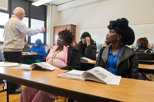 Mary Buak, right, and Nyawargak Jack, center, listen to teacher Tom Tacheny during a citizenship class at Lincoln Community Center on Wednesday. Tacheny said that he has always had a big group in his citizenship class. Photo by Jackson Forderer