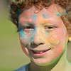Josiah Gioffre, 8, was one of roughly 250 people to participate in Saturday's Monroe Color Run held at Spring Lake Park. Runners went through four different stations where colored was thrown at them as they ran around the lake. Photo by Jackson Forderer