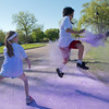A participant in the Monroe Color run tries his best to avoid getting colored by Monroe Elementary principal Steve Johanson (right) and his daughter Elsie, 7, on Saturday at Spring Lake Park. Photo by Jackson Forderer