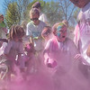 Children participants of the Monroe Color Run play with the leftover pink powder that was used during the run at Spring Lake Park. The run benefited the snack cart program at Monroe Elementary. Photo by Jackson Forderer