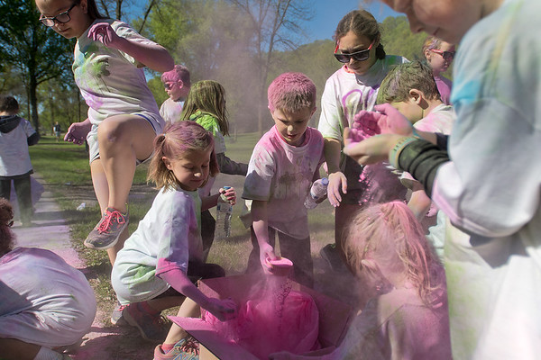 Children participants of the Monroe Color Run play with the leftover pink powder that was used during the run at Spring Lake Park. The run had roughly 250 participants, many of them Monroe Elementary Students. Photo by Jackson Forderer