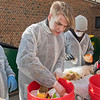 From left, Sam Murray, Ben Liebl, Joseph Peterson and Sam Preis, members of the Yes! Team from Mankato West, sort through the garbage at Roosevelt Elementary to pick out the items that are recyclable and compostable. The sorting is the start of a project aimed at reducing the trash output in the school district. Photo by Jackson Forderer