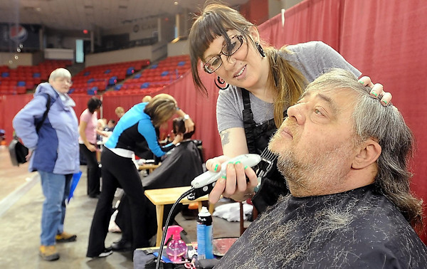 John Cross<br /> Volunteer Angela Schafer of Mia & Maxx Hair Studio trims Watonwan County resident Kim McCulloch's beard Tuesday during the South Central Minnesota Project Community Connect at the Verizon Wireless Center.