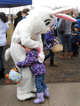 Jocelyn Pemble, 3, gets a hug from the Easter Bunny.