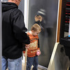 Tyler Jordan, 11, peers through a frosted glass window at his brother Brayden, 5, and his father Todd at the Southern Minnesota Home and Builders Show at the Verizon Wireless Center.