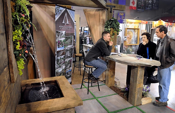 Luke Erickson of Aquatic Gardens and Landscaping talk to visitors Friday at the Southern Minnesota Home and Builders Show at the Verizon Wireless Center.