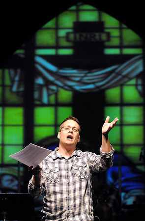 Chris Pappenfus, pastor of student ministries at Crossview Covenant Church in North Mankato, rehearses a reading Saturday in preparation for the church's Easter Sunday services.