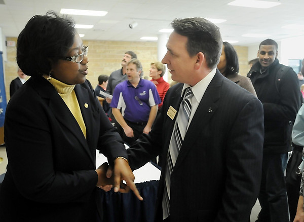 John Cross<br /> Annette Parker, the new president of South Central College, visits with W.C. Sanders, SCC Dean of Academic Affairs, during a reception Thursday to introduce her to faculty.