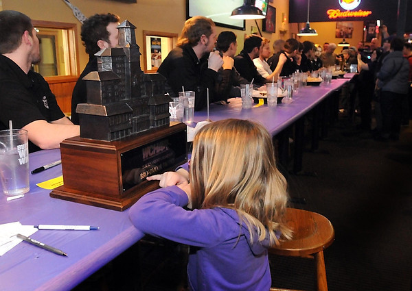 A young fan gets a close look at the Broadmoor Trophy during a sendoff part for the Minnesota State men's hockey team Wednesday at the downtown Buffalo Wild Wings. Pat Christman