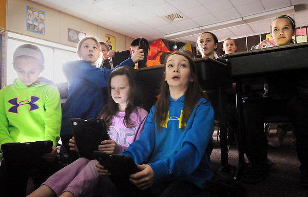 Fourth and fifth graders at Hilltop Elementary School in Henderson use electronic tablets to participate in a STEM class quiz.