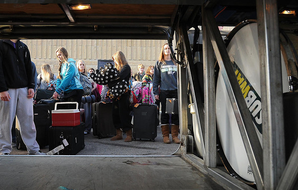 Mankato East High School choir, band and orchestra members wait to load luggage and instruments on to waiting buses on Friday for a trip to West Point. The students will perform there and at several other venues in the area during the largest school trip ever taken by East High School students.
