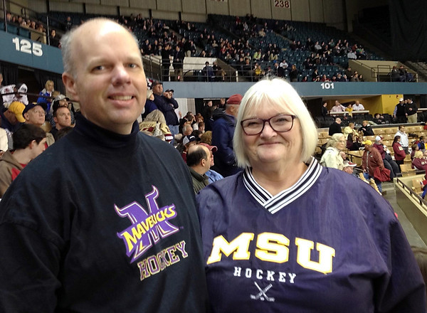 Shane Frederick<br /> Ann Peterson (right) and her son, Mark Muir, made the hour drive to Worcester, Mass., on Saturday to watch the Minnesota State men's hockey team play in the NCAA Northeast Regional at the DCU Center. Peterson was an instructor at South Central College for 13 years. She now lives in Windham, N.H.
