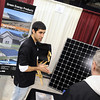 Green Energy Products' Drew McCabe talks with a visitor to the company's booth at the Southern Minnesota Home and Builders Show. Pat Christman