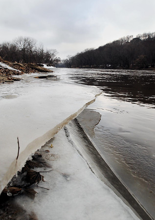 Receding water levels at the confluence of the Minnesota and Blue Earth Rivers in Mankato left sheets of ice hanging from the shoreline. Flooding threats are minimal this spring in most of Minnesota. Photo by John Cross