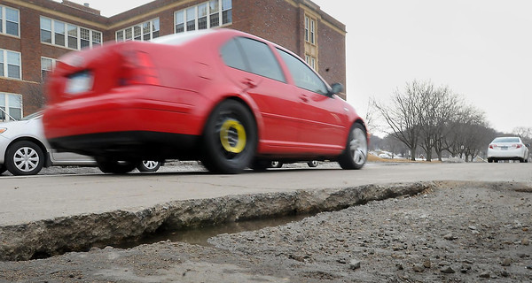 Robins indeed may be a sign of spring for some. But for Mankato motorists, a less benign sign of spring's impending arrival might be the potholes that now are springing on some streets.A particularly nasty stretch of the suspension-eaters are on South Fifth Street between Main Street and Cherry Streets.