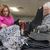Tabby Caballero (left) and Sue Frost look through pants<br /> Photo by Jackson Forderer