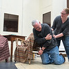 Angela Dugan (right), playing the role of Ethel Thayer, tries to comfort Mark Braun, playing Ethel's husband Norman Thayer, as he acted out having a heart attack during a rehearsal for On Golden Pond at Centenary United Methodist Church on Tuesday. Photo by Jackson Forderer