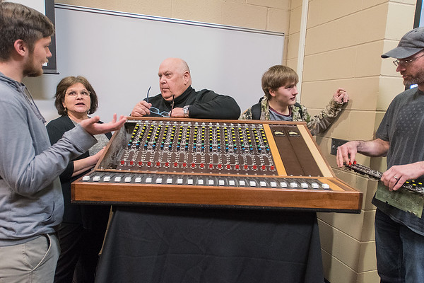 From left, Robert Mejias, Patty Mejias, Rob Colby, Cooper Davidson and Charles Norway talk around a soundboard after Colby gave a presentation at South Central College on Thursday. Colby is donating the soundboard to the college.<br /> Photo by Jackson Forderer