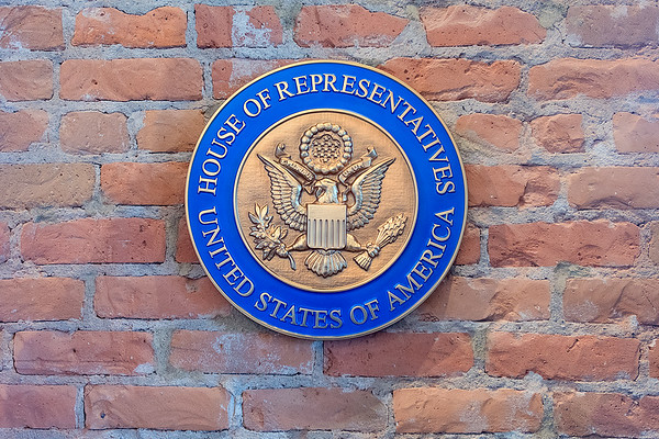 The official House of Representatives seal on the wall at the constituent services office. The office serves District 1 in Minnesota. Photo by Jackson Forderer