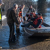 Rescue crews from Blue Earth and Nicollet counties help 89-year old Earl Hansen (second from right) back to dry land after the rising waters of the Watonwan River caused flooding in Garden City on Tuesday. Photo by Jackson Forderer/Mankato Free Press