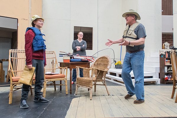 Mark Braun (right), playing the role of Norman Thayer, talks to Britton Beran (left), playing the role of Billy Ray, during a rehearsal of the play On Golden Pond at Centenary United Methodist Church on Tuesday. Also pictured is Angela Dugan (center), playing the role of Ethel Thayer. Photo by Jackson Forderer
