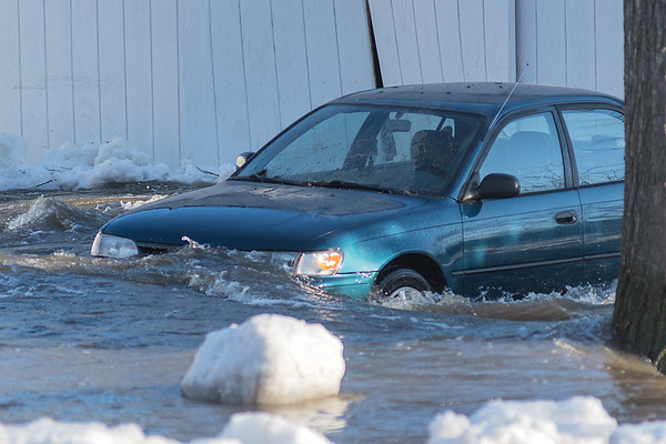 The car of Robert Kewatt in his driveway in Garden City on Tuesday as the waters of the Watonwan River rose up. Photo by Jackson Forderer