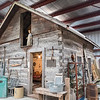 A lob cabin is one of the larger displays at the Watonwan County Historical Society in Madelia. Pam Sandbo, the new director, said that they hope to expand with a new building for farm machinery and have more displays of the smaller communities in Watonwan County. Photo by Jackson Forderer