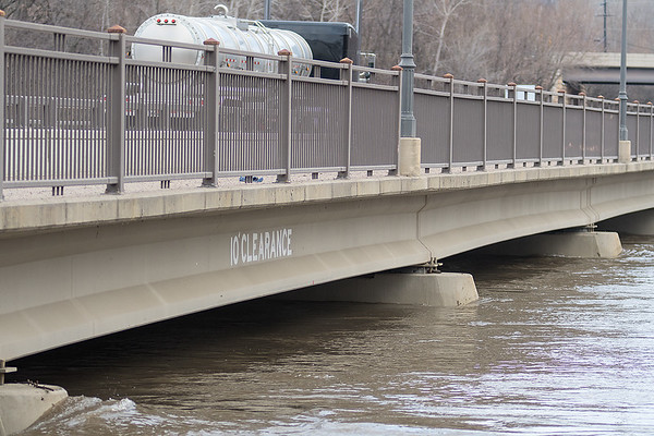 A sign that says 10 feet of clearance on the span of Highway 22 that crosses the Minnesota River south of St. Peter. Photo by Jackson Forderer